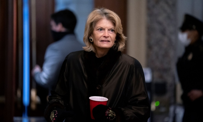 Sen. Lisa Murkowski (R-Alaska) arrives before the fifth day of the Senate Impeachment trials for former President Donald Trump on Capitol Hill on February 13, 2021 in Washington. (Stefani Reynolds/Getty Images)