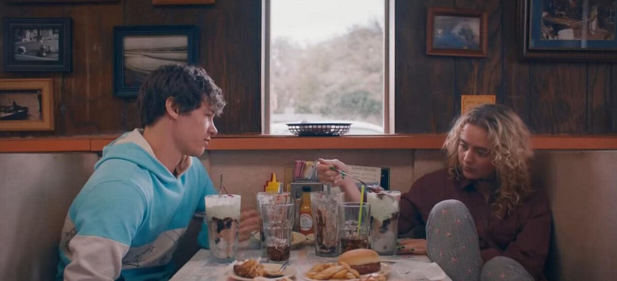 boy and girl sit in diner in The Map of Tiny Perfect Things