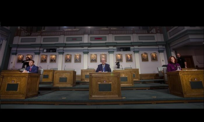 (L-R) Liberal Leader Andrew Furey, Progressive Conservative Leader Ches Crosbie, and NDP Leader Alison Coffin sit prior to the start of their televised debate from the floor of the House of Assembly in St. John's N.L. on Feb. 3, 2021. (The Canadian Press/Paul Daly)