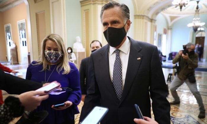 Sen. Mitt Romney (R-Utah) talks to reporters on Capitol Hill in Washington on Feb. 13, 2021. (Chip Somodevilla/Getty Images)