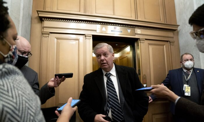 Sen. Lindsey Graham (R-S.C.) speaks with reporters in Washington on Feb. 13, 2021. (Stefani Reynolds/Pool/Getty Images)