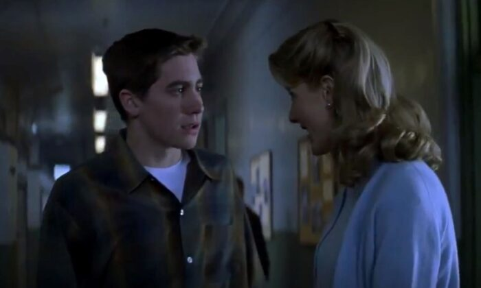 """A teen with a dream, Homer Hickam  (Jake Gyllenhaal) and his encouraging teacher (Laura Dern), in """"October Sky."""" (Universal Pictures)"""