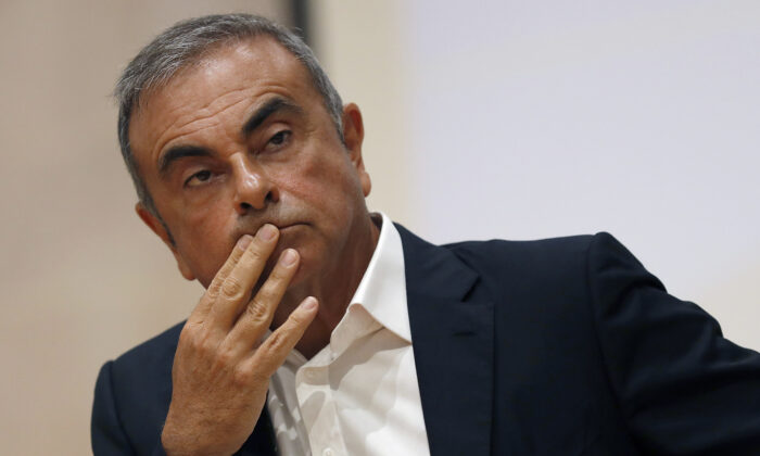 Former Nissan Motor Co. Chairman Carlos Ghosn holds a press conference at the Maronite Christian Holy Spirit University of Kaslik, Lebanon, on Sept. 29, 2020. (Hussein Malla/ AP Photo)