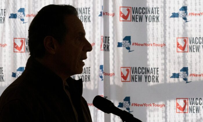 Gov. Andrew Cuomo speaks to reporters during a news conference at a COVID-19 pop-up vaccination site in the William Reid Apartments in the Brooklyn borough of New York on Jan,. 23, 2021. (Mary Altaffer/Pool/AP)