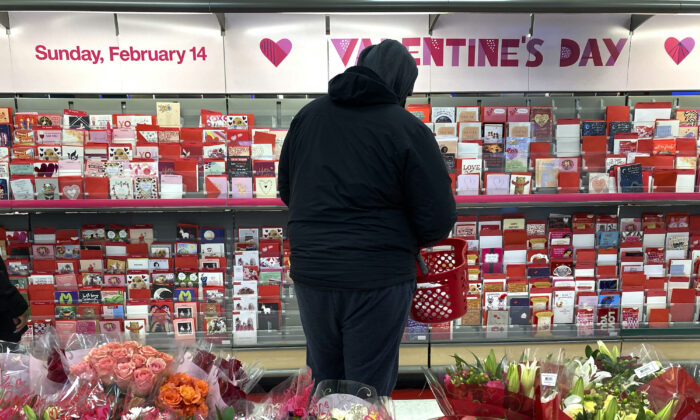 A shopper looks over Valentine's Day cards at a Chicago area store on Feb. 13, 2021. (Charles Rex Arbogast/AP)