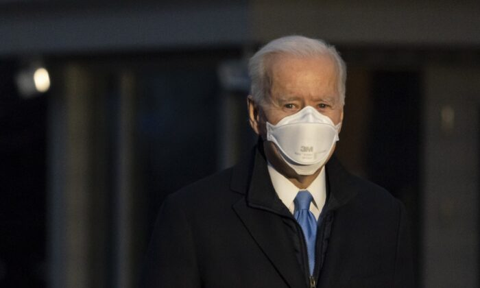 President Joe Biden pauses to speak with reporters as he walks to Marine One for departure from the White House, on Feb. 12, 2021. (Alex Brandon/AP Photo)