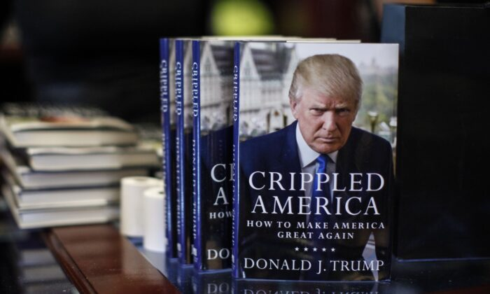 "Then-Republican primary contender Donald Trump's new book ""Crippled America: How to Make America Great Again"" on display at Trump Tower in Manhattan, N.Y., on Nov. 3, 2015. (Kena Betancur/AFP via Getty Images)"
