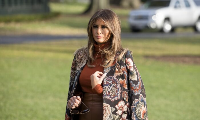 First Lady Melania Trump waits as President Donald Trump talks to reporters before departing with his family from the White House to his Mar-a-Lago resort in Florida for the Thanksgiving holiday, in Washington on Nov. 21, 2017. (Samira Bouaou/The Epoch Times)