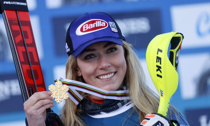 Gold medalist Mikaela Shiffrin of the U.S. celebrates with her medal on the podium after the women's Alpine Combined in Cortina d'Ampezzo, Italy, on Feb. 15, 2021. (Leonhard Foeger/Reuters)