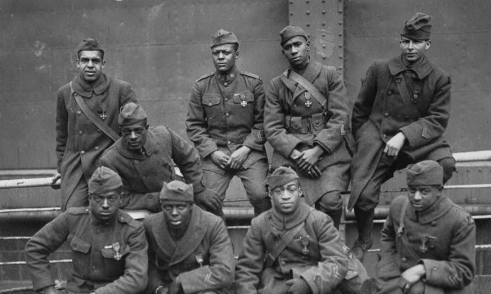 Some of the soldiers of the 369th Infantry Regiment (known as the 15th New York National Guard Regiment) who were awarded the French Croix de Guerre for gallantry in action, 1919. (L-R) Front row: Pvt. Ed Williams, Herbert Taylor, Pvt. Leon Fraitor, Pvt. Ralph Hawkins. Back row: Sgt. H. D. Prinas, Sgt. Dan Storms, Pvt. Joe Williams, Pvt. Alfred Hanley, Cpl. T. W. Taylor. (Public domain)