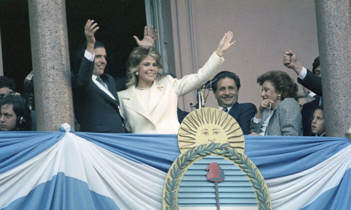 Argentina's President Carlos Menem, accompanied by his wife Zulema Yoma, waves from the balcony of the Government Palace, after being sworn in as the new President of Argentina, in Buenos Aires, Argentina on July 8, 1989. (Alejandro Querol/AP Photo, File)