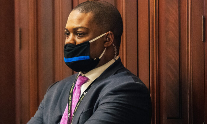 Capitol Police Officer Eugene Goodman watches newly released video footage of the Jan. 6 attack on the Capitol Building during the second day of the impeachment trial of former President Donald Trump in Washington on Feb. 10, 2021. (Brandon Bell-Pool/Getty Images)