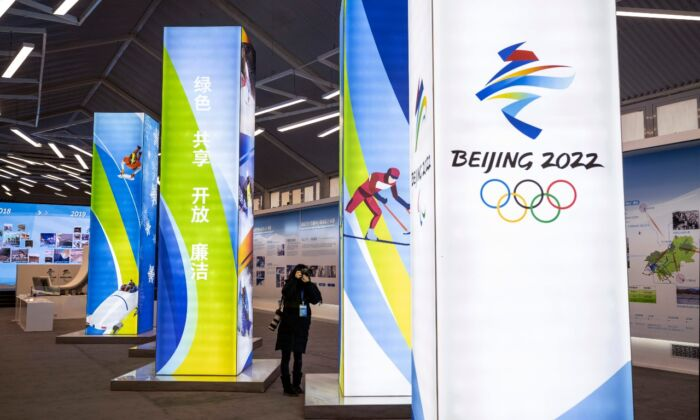 A journalist takes pictures of a display at the exhibition center for the Beijing 2022 Winter Olympics in Yaqing district on in Beijing, China, on Feb. 5, 2021. (Kevin Frayer/Getty Images)