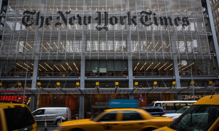 Traffic drives past The New York Times building in New York City on Oct. 1, 2014. (Andrew Burton/Getty Images)