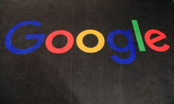 The logo of Google is displayed on a carpet at the entrance hall of Google in Paris, France, on Nov. 18, 2019. (Michel Euler/AP Photo)