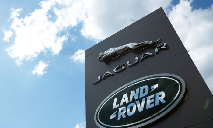 The Jaguar Land Rover logo is seen at a dealership in Milton Keynes, Britain, on June 1, 2020. (Andrew Boyers/Reuters)