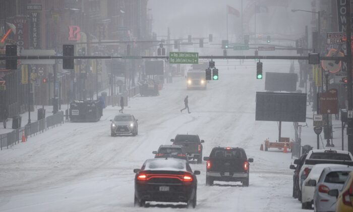 General view of Lower Broadway as vehicles and people traverse through snow and ice in Nashville, Tenn., on Feb. 15, 2021. (Brett Carlsen/Getty Images)