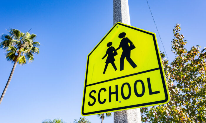 A school road sign near a Newport-Mesa Unified School District school in Costa Mesa, Calif., on Dec. 1, 2020. (John Fredricks/The Epoch Times)
