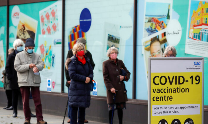 People queue to receive the CCP virus vaccine outside a closed down Debenhams store that is being used as a vaccination centre in Folkestone, Kent, UK, on Jan. 28, 2021. (Andrew Couldridge/Reuters)