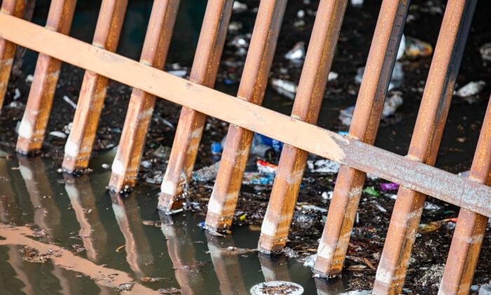 Trash litters the water near a storm drain in the Venice Beach area of Los Angeles on Jan. 27, 2021. (John Fredricks/The Epoch Times)