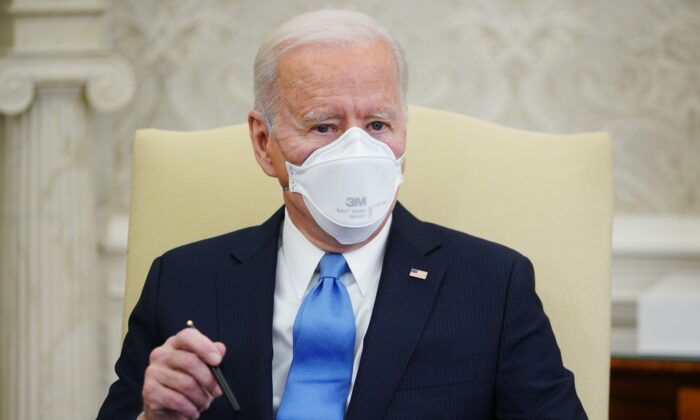 President Joe Biden speaks during a meeting with a bipartisan group of governors and mayors on his COVID-19 relief plan, in the Oval Office of the White House in Washington on Feb.12, 2021. (Mandel Ngan/AFP via Getty Images)