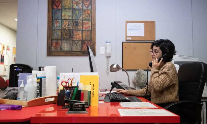 Crisis line volunteer Shoak Alhussami at Battered Women's Support Services in Vancouver. (Darryl Dyck/The Canadian Press)
