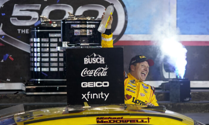 Michael McDowell celebrates after winning the NASCAR Daytona 500 auto race at Daytona International Speedway, in Daytona Beach, Fla., on Feb. 15, 2021. (John Raoux/AP Photo)