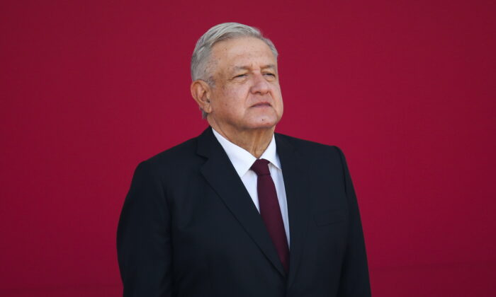 """Mexican President Andres Manuel Lopez Obrador gestures during the 108th anniversary of the epic military feat known as """"March of Loyalty"""", after he faced a coronavirus disease infection at the Chapultepec Castle in Mexico City, Mexico, on Feb. 9, 2021. (Edgard Garrido/File/Reuters)"""