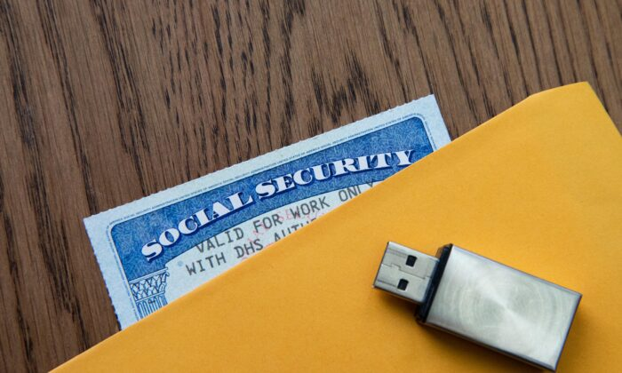 A social security card with a USB and an envelope in New York, on Feb. 14, 2021. (Chung I Ho/The Epoch Times)