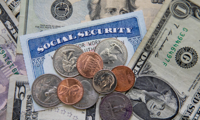 A social security card with coins and cash in New York on Feb. 14, 2021. (Chung I Ho/The Epoch Times)