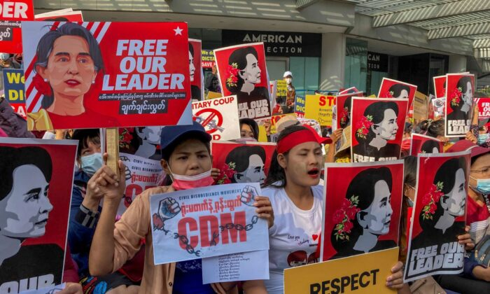 Demonstrators display images of detained Burma leader Aung San Suu Kyi during a protest against the military coup in Yangon, Burma, on Feb. 16, 2021. (AP Photo)
