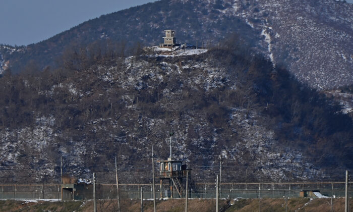 A North Korean guard post (top) is seen over a South Korean military fence (bottom) from the border city of Paju on Dec. 15, 2020. (Jung Yeon-je/AFP via Getty Images)