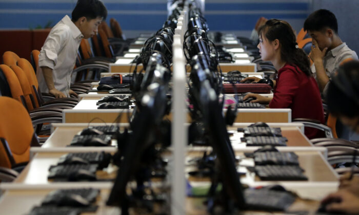 North Korean men and women use computer terminals at the Sci-Tech Complex in Pyongyang, North Korea, on June 16, 2017. (Wong Maye-E/File/AP Photo)