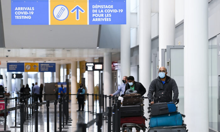Travellers arrive at the Toronto Pearson International Airport in Toronto on Feb. 1, 2021. (THE CANADIAN PRESS/Nathan Denette)