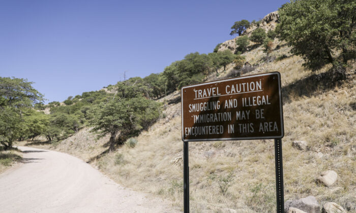A sign in Carr Canyon warns of possible smuggling and illegal immigrants in the area, near the U.S.-Mexico border in Sierra Vista, Arizona, on May 5, 2019. (Charlotte Cuthbertson/The Epoch Times)