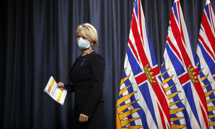 Dr. Bonnie Henry leaves the podium after talking about the next steps in B.C.'s COVID-19 Immunization Plan during a press conference at Legislature in Victoria, B.C., Canada, on Jan. 22, 2021. (Chad Hipolito/The Canadian Press)