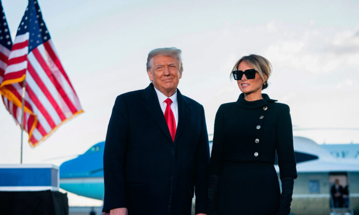 Former US President Donald Trump and First Lady Melania Trump address guests at Joint Base Andrews in Maryland on January 20, 2021. - President Trump and the First Lady travel to their Mar-a-Lago golf club residence in Palm Beach, Florida, and will not attend the inauguration for President-elect Joe Biden. (Photo by ALEX EDELMAN / AFP) (Photo by ALEX EDELMAN/AFP via Getty Images)