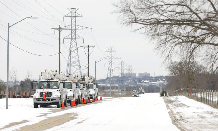 Pike Electric service trucks line up after a snowstorm in Fort Worth, Texas, on Feb. 16, 2021. (Ron Jenkins/Getty Images)