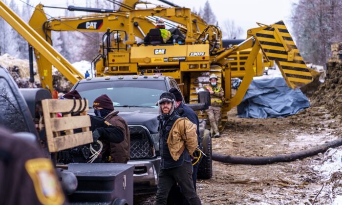 "Aitkin County sheriffs arrest ""water protectors"" during a protest at the construction site of the Line 3 oil pipeline near Palisade, Minn., on Jan. 9, 2021. (Kerem Yucel/AFP via Getty Images)"