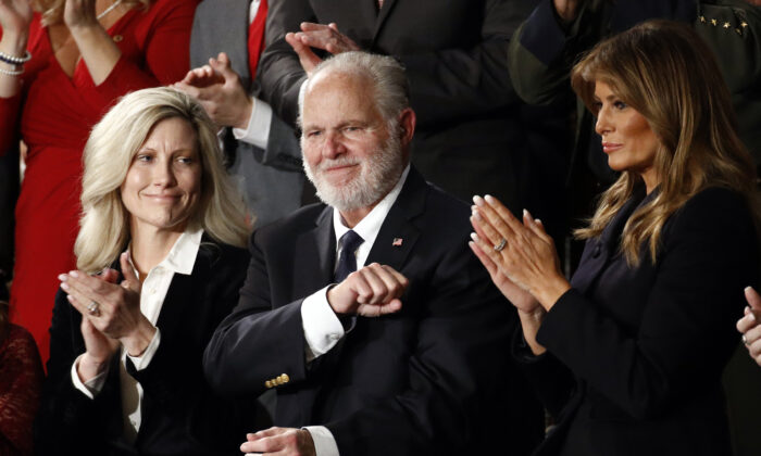 Rush Limbaugh reacts as First Lady Melania Trump, and his wife Kathryn, applaud, as President Donald Trump delivers his State of the Union address to a joint session of Congress on Capitol Hill in Washington on Feb. 4, 2020. (Patrick Semansky/AP Photo)
