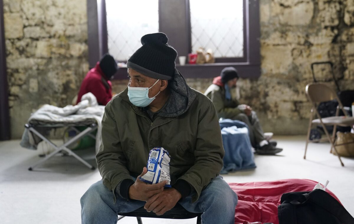 People seeking shelter from sup-freezing