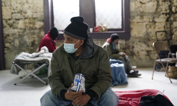 People seeking shelter from sup-freezing temperatures gather at a make-shift warming shelter at Travis Park Methodist Church in San Antonio, Texas, on Feb. 16, 2021. (Eric Gay/AP Photo)