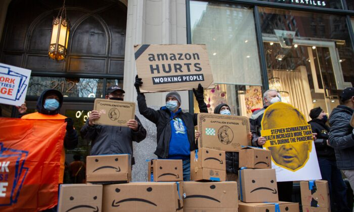 Amazon workers and community allies demonstrate during a protest organized by New York Communities for Change and Make the Road New York in front of the Jeff Bezos' Manhattan residence in New York, on Dec. 2, 2020. (Kena Betancur/AFP via Getty Images)