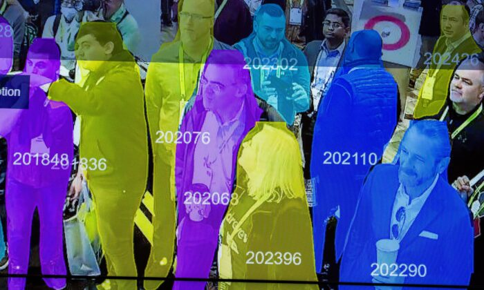 A live demonstration uses artificial intelligence and facial recognition in dense crowd spatial-temporal technology at an exhibit in Las Vegas on Jan. 10, 2019. (David McNew/AFP via Getty Images)