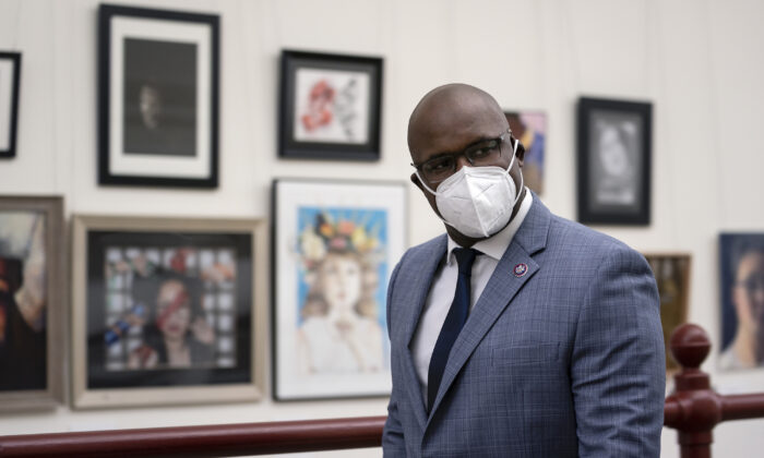 Rep. Jamaal Bowman (D-N.Y.) wears a mask as he walks through the Canon Tunnel to the U.S. Capitol in Washington on Jan. 12, 2021. (Stefani Reynolds/Getty Images)