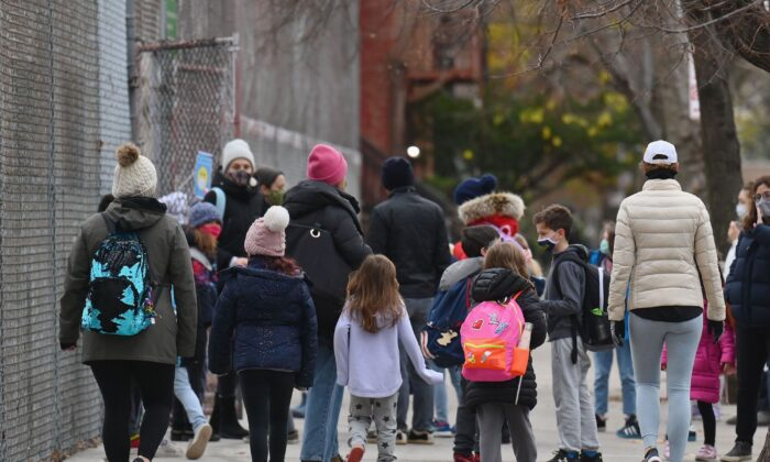 Children arrive for class on the first day of school reopening in Brooklyn, New York City, N.Y.,  on Dec. 7, 2020. (Angela Weiss/AFP via Getty Images)