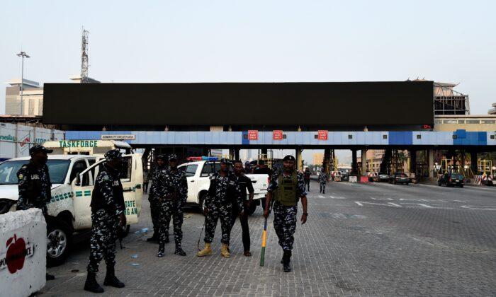 Nigerian policemen man a tollgate at Lekki district in Lagos, on Feb. 13, 2021. (Pius Utomi Ekpei/AFP via Getty Images)