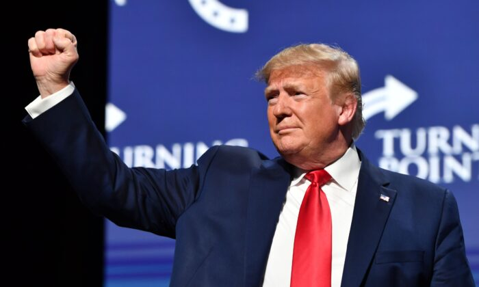 President Donald Trump gestures during the Turning Point USA Student Action Summit at the Palm Beach County Convention Center in West Palm Beach, Fla., on Dec. 21, 2019. (Nicholas Kamm/AFP via Getty Images)