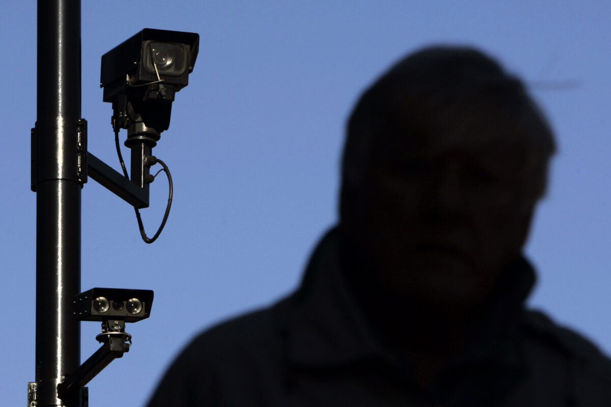 A security camera overlooks a man