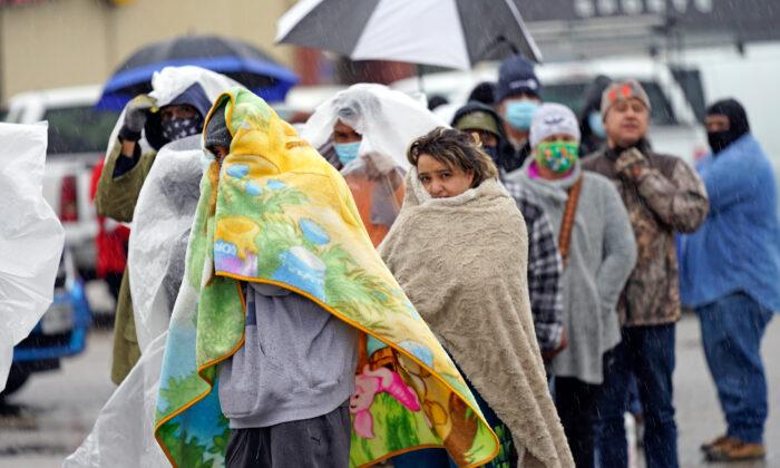 People wait in line to fill propane tanks in Houston, Texas, on Feb. 17, 2021. (David J. Phillip/AP Photo)